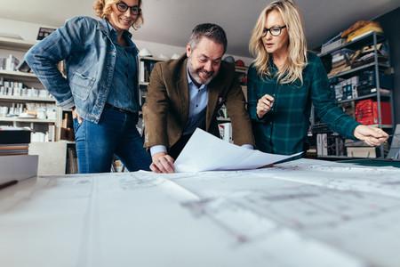 Designers finalize a housing construction plan