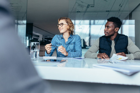 Female executive listening to her colleague during meeting