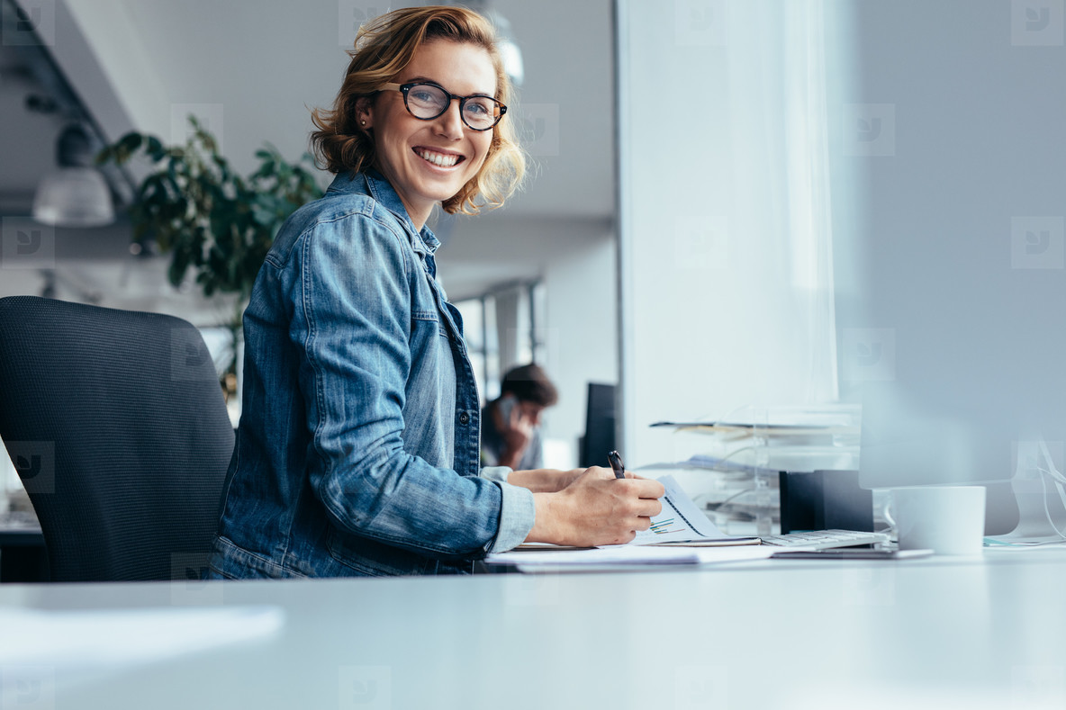 Female manager working at her desk