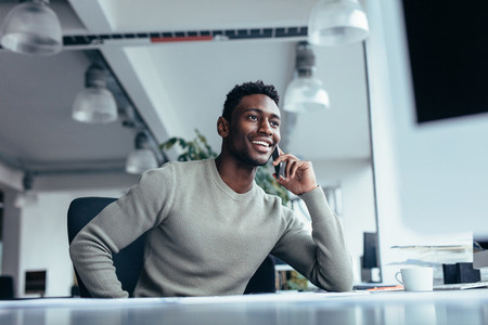 Male executive making phone call in office