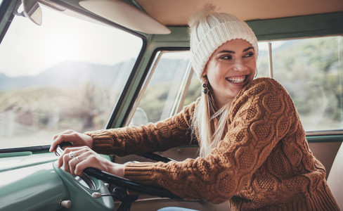 Beautiful woman enjoying her road trip