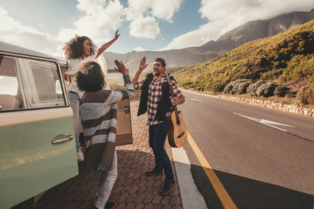 Group of friends enjoying on road trip