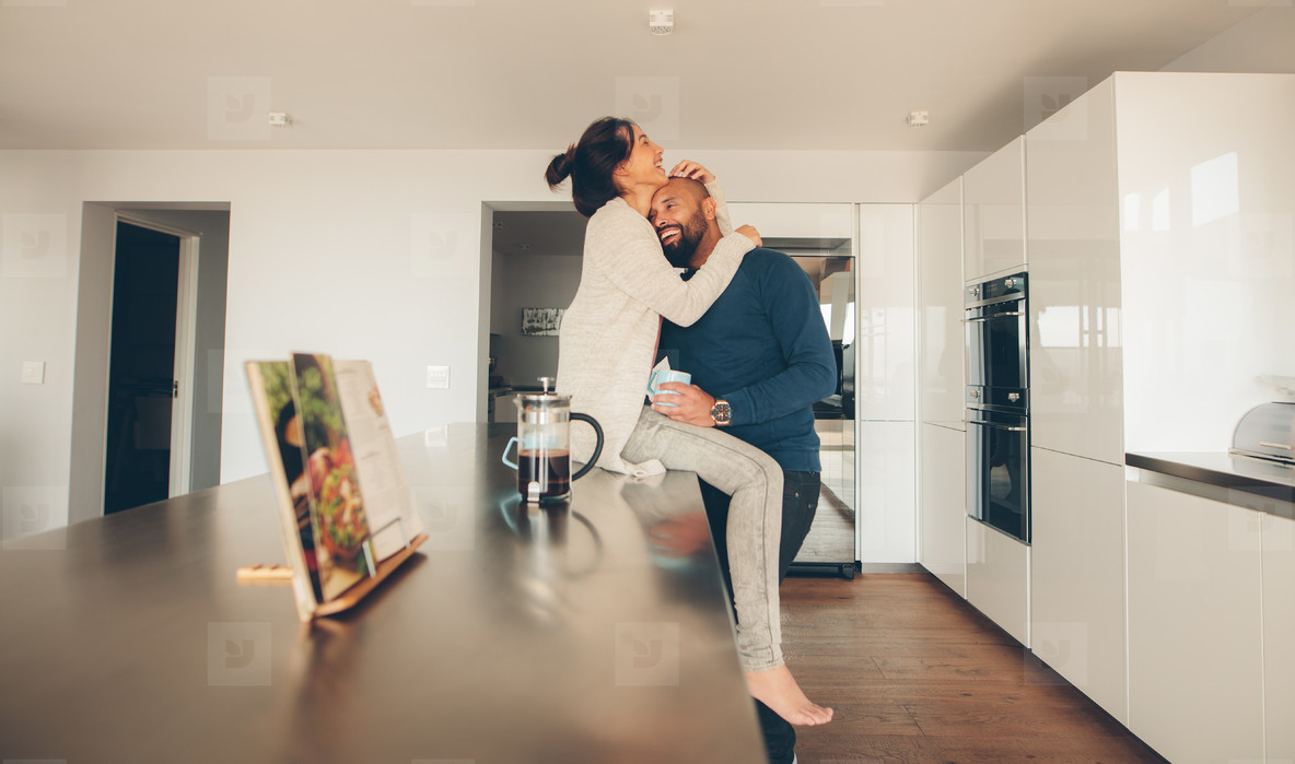 Loving young couple in morning in kitchen