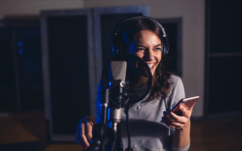 Female singer singing in recording studio