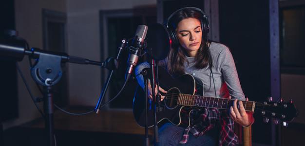 Female singer performing a song in studio