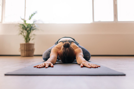 Fitness woman working out on yoga mat