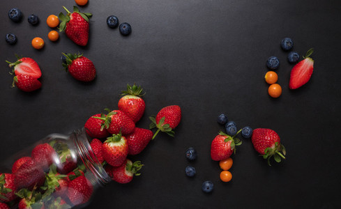 Fresh fruits scattered on table