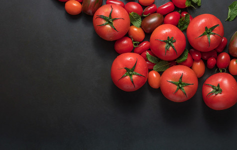 Tomatoes and mint on table