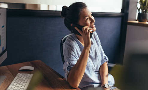Female business professional making a phone call