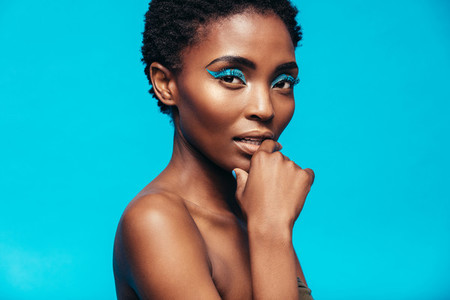 Sensual african female model with vivid makeup