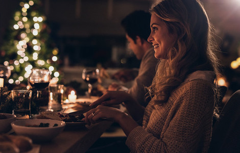 Beautiful woman having christmas dinner with family