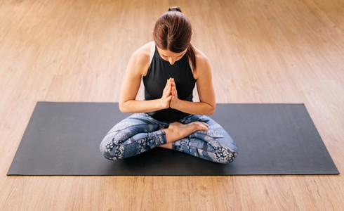 Woman in ardha padmasana yoga pose