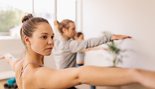 Fitness people doing yoga in gym class