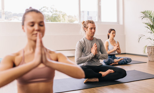 People meditating in yoga class