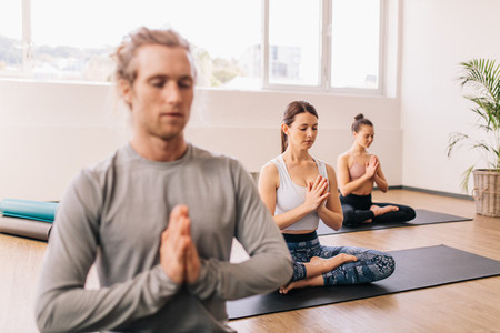 Group of people meditating in a yoga studio