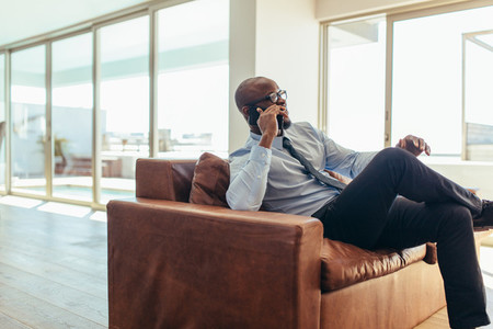 Businessman talking over mobile phone