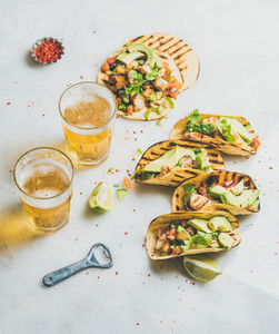 Gluten free healthy corn tortillas with beer in glasses