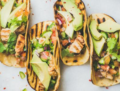 Gluten free healthy corn tortillas with grilled chicken fillet  avocado  salsa