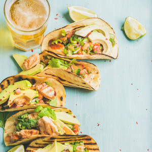 Corn chicken and avocado tortillas  beer in glass  square crop