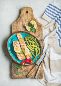 Roasted salmon fillet with lemon  rosemary  chilli pepper  green beans