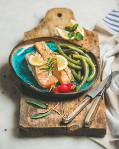 Roasted salmon fish with lemon  rosemary  chilli pepper and beans