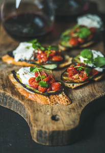 Red wine brushetta with vegetables cream cheese and arugula