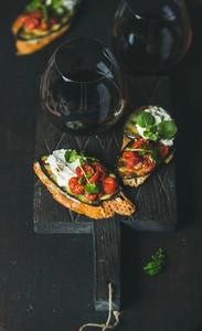 Wine and brushetta with eggplant  tomatoes  garlic  cream cheese  arugula