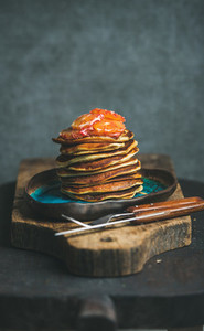 Pancakes with honey and bloody orange slices  copy space