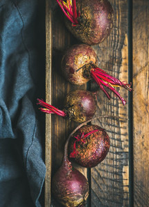 Raw organic purple beetroots in wooden box
