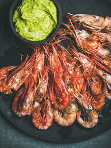 Roasted red shrimps with guacamole avocado sauce top view