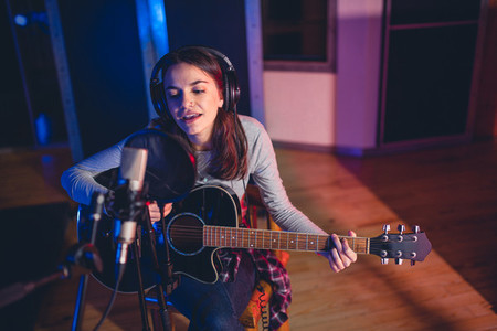Woman performing in a recording studio