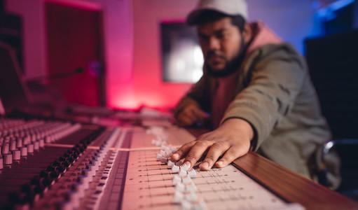 Sound engineer working on music mixer