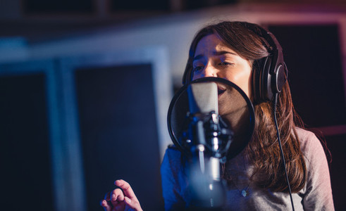 Woman recording a song for her new album