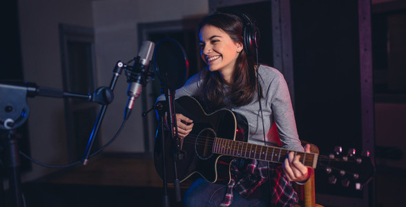 Singer recording her album in music studio