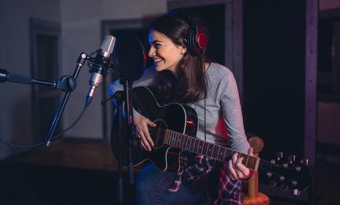 Professional musician recording in studio