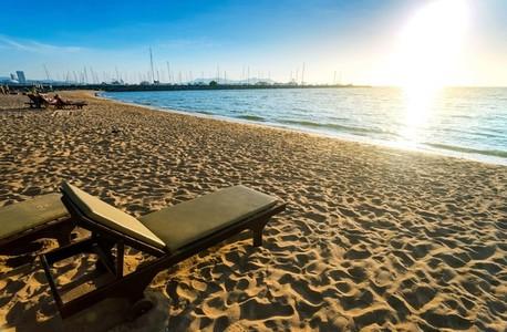 Beach chair on the sand at Pattaya Thailand