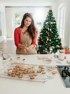 Woman preparing cookies for Christmas