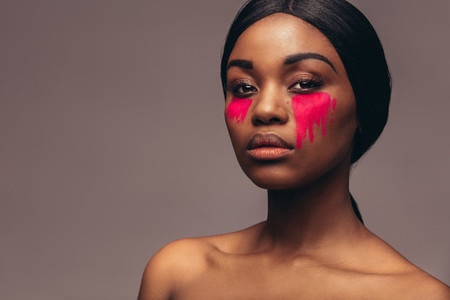 African woman with dramatic eye makeup