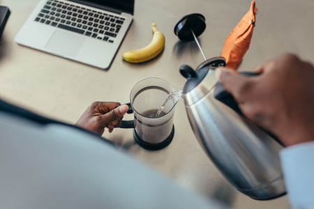 Man preparing coffee at home
