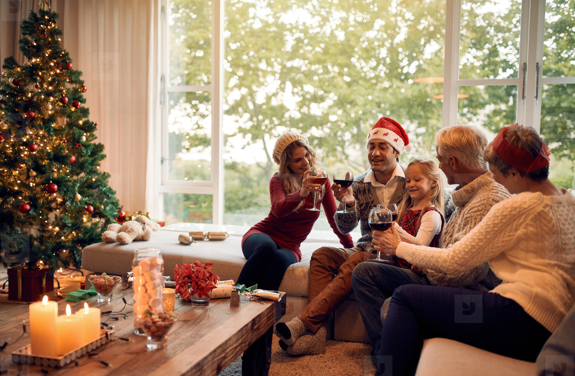 Family celebrating christmas with wine