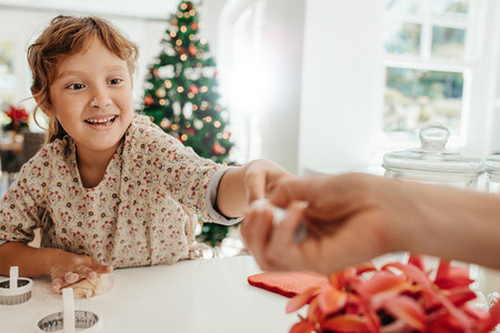 Little girl making cookies for Christmas