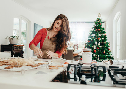Woman preparing cookies for Christmas