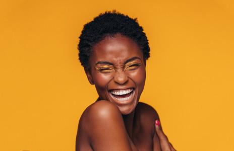 Cheerful woman with vivid eye makeup