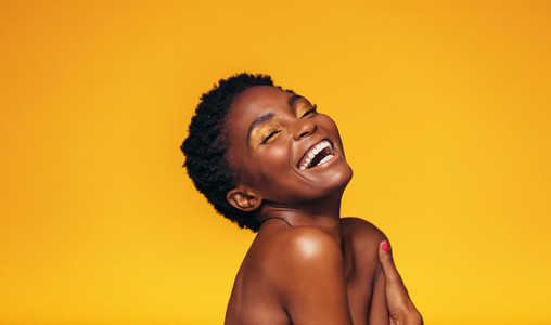 Laughing african female model with makeup