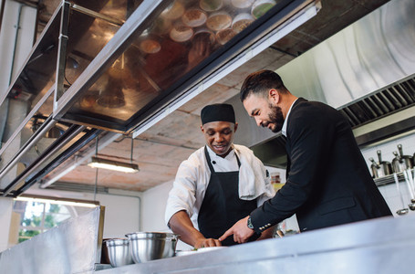 Restaurant manager with chef in kitchen