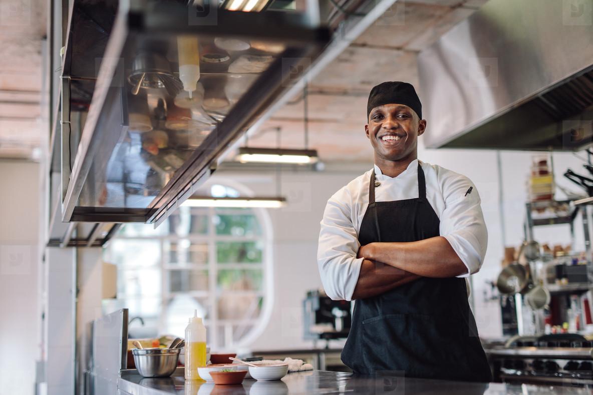 Chef standing at restaurant kitchen