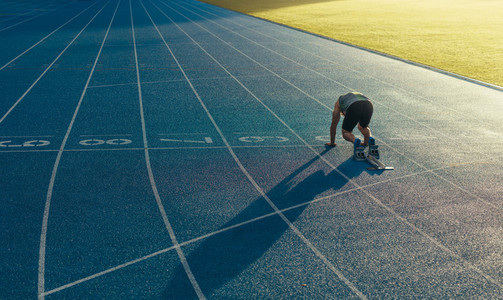 Sprinter on his marks on a running track
