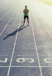 Sprinter standing on running track
