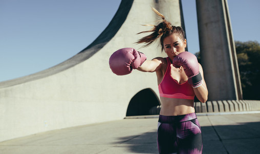 Sportswoman doing boxing working outdoors