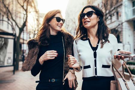 Female friends walking on the road